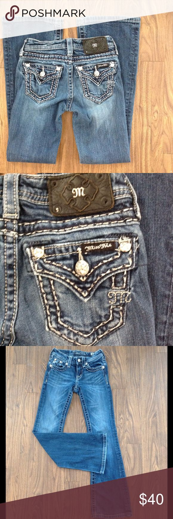 Girls miss me jeans boot cut bling denim pockets Miss me jeans. Bling back pockets. Wide stitching. Bootcut style. Dark wash. Size 8 girls. Missing four stones around the leather patch. See last pic.Good preowned condition. Miss Me Bottoms Jeans
