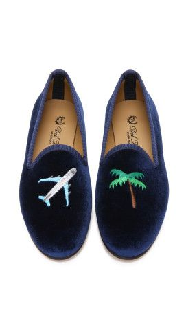 Del Toro Jetsetter Smoking Slippers. Classic velvet Del Toro smoking slippers feel modern and playful, detailed with bold, mismatched appliqués. Rope trim traces the notched top line, and a contrast stripe accents the heel. Leather sole.