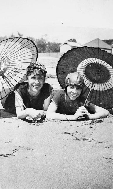 Beach girls posing under their umbrellas, Brisbane, ca. 1925
