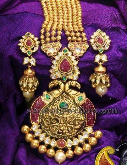 Jewellery Designs: Kundan Haram with Peacock Pendant