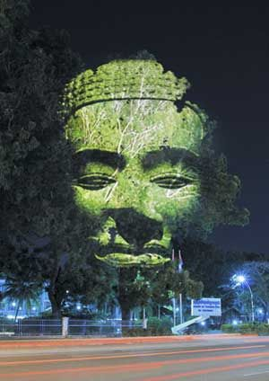 French artist Clement Briend recently traveled to Cambodia, where he photographed sculptures of Cambodian deities and projected them on urban trees. http://restreet.altervista.org/briend-clemente-trasforma-gli-alberi-in-divinita/