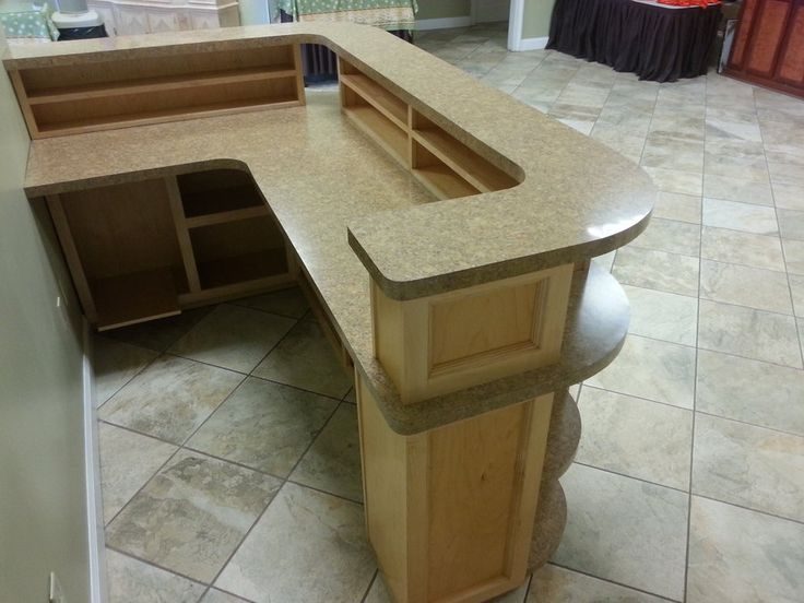 Make L-shape or even wrap around past mail area making it u-shape . The portion behind the secretary would not be desk deep. 1 ft deep maybe for sorting or stapling