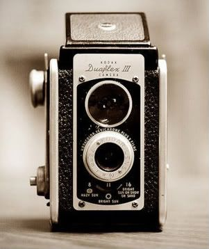 I love photography. I love old vintage things. I actually own one of these that was my amazing Grandma & Grandpa's that they used when they first got married. <3