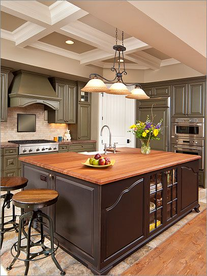 Furniture style kitchen island looks elegant and sophisticated.