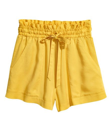 Check this out! CONSCIOUS. Wide-cut, high-waisted shorts in woven Tencel® lyocell fabric. Side pockets, waistband with elastication and drawstring, and ruffled edge at top. - Visit hm.com to see more.