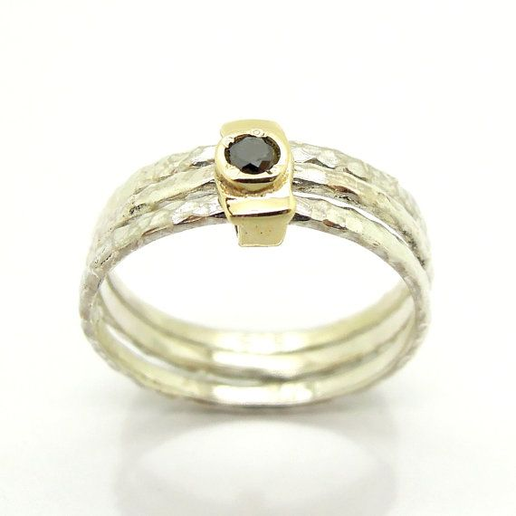Black diamond ring set in gold stacking hammered silver bands