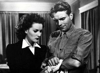 Maureen O'Hara and Kent Smith in This Land is Mine (1943) Paul Martin, Louise's brother, tried to kill the German commandant Major von Keller, but instead kills two soldiers.