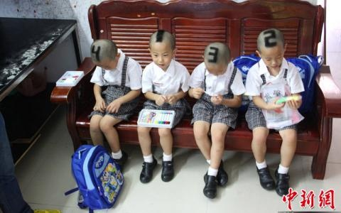 In Guangdong Province the parents of four young boys have had their hair shaved into the numbers 1, 2, 3, 4 to make it easier for teachers and classmates to tell them apart.