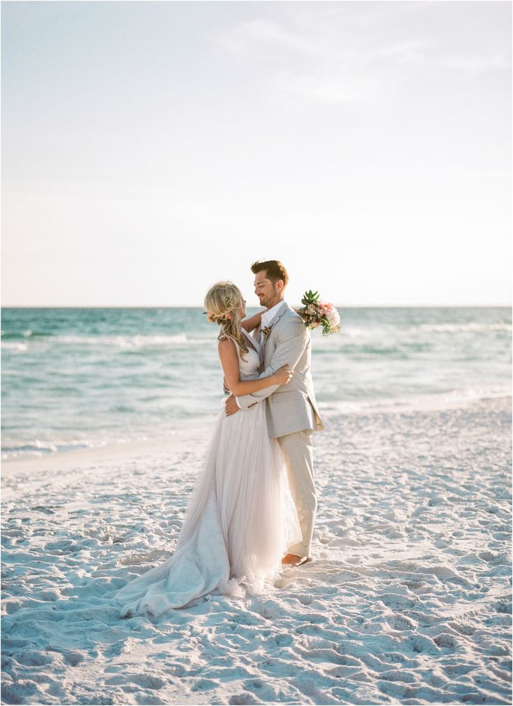 Stunning blush, pink and cream beach wedding. Bride's dress is by Essense of Australia