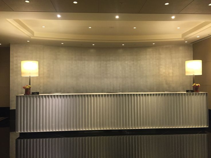 CROWN TOWERS 7: This concierge area is quite simple. The back wall is painted in silver. The way the strokes are give the wall texture. It's simple and still elegant.