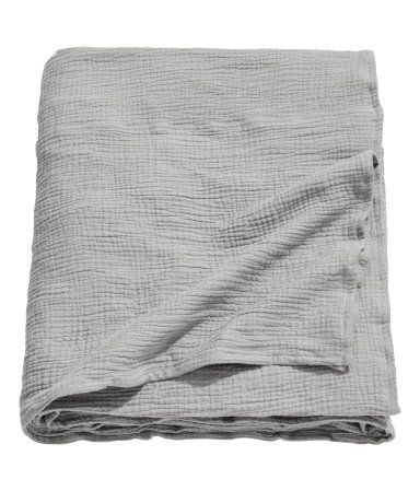 Gray. Twin bedspread in woven, crinkled cotton fabric.