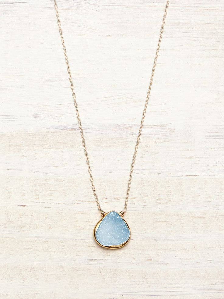 Our beautifully unique, floating Druzy necklace features a Blue, crystalline Agate Rock Geode, framed in Gold, and set to float effortlessly on a delicate chain. Each necklace is a special treasure an