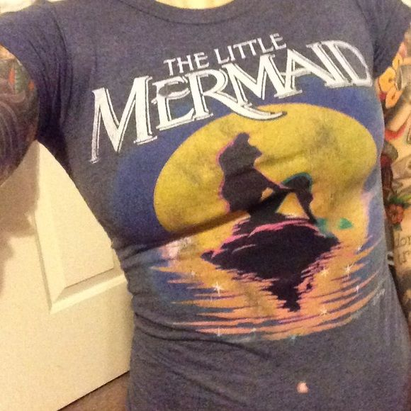 Little mermaid t shirt Adorable little mermaid shirt. Has two bleach spots in the front. But they actually look cute and match the design! Junk Food Tops Tees - Short Sleeve