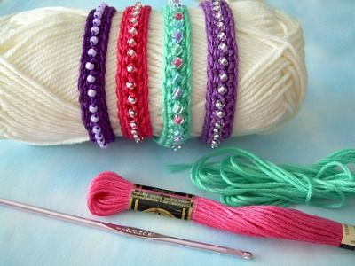 The materials are fairly inexpensive: crochet hook, embroidery floss, beads, and a clasp.