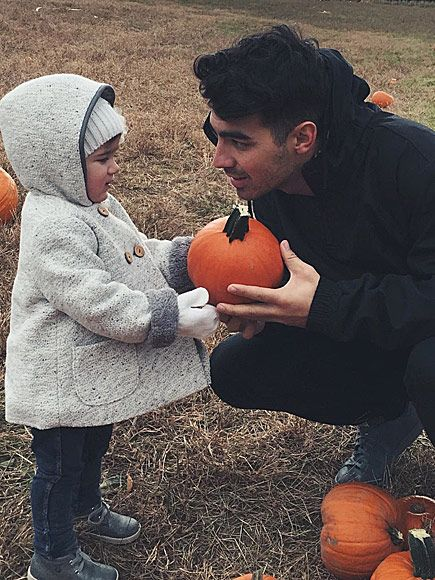 Hollywood's Cutest Lil' Pumpkin Pickers | DANIELLE JONAS | Alena Rose, daughter of Kevin Jonas and wife Danielle, clocks in time with uncle Joe during a day of fall family fun.