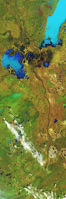 Space in Images - 2014 - 09 - Alberta, Canada. This Landsat-8 image covers a distance of over 350 km from top to bottom, all within Canada's Alberta province. The lower half of the image is part of a wider area known as the Athabasca oil sands, which has the world's largest known reservoir of crude bitumen, which can be upgraded to crude oil using technology that extracts the oil from the soil using chemicals.