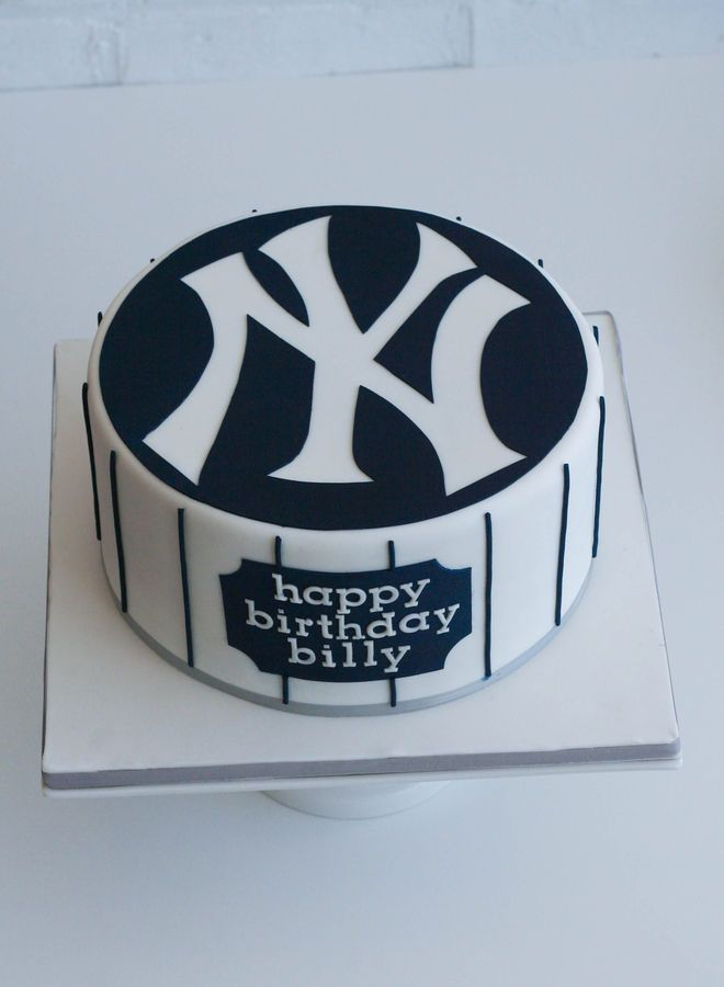 """Single-tier 8"""" cake (chocolate cake with Bailey's French buttercream). New York Yankees logo hand cut in the negative out of blue circle (rather than being appliqued on). FMM Tappits alphabet letters used for happy birthday plaque."""