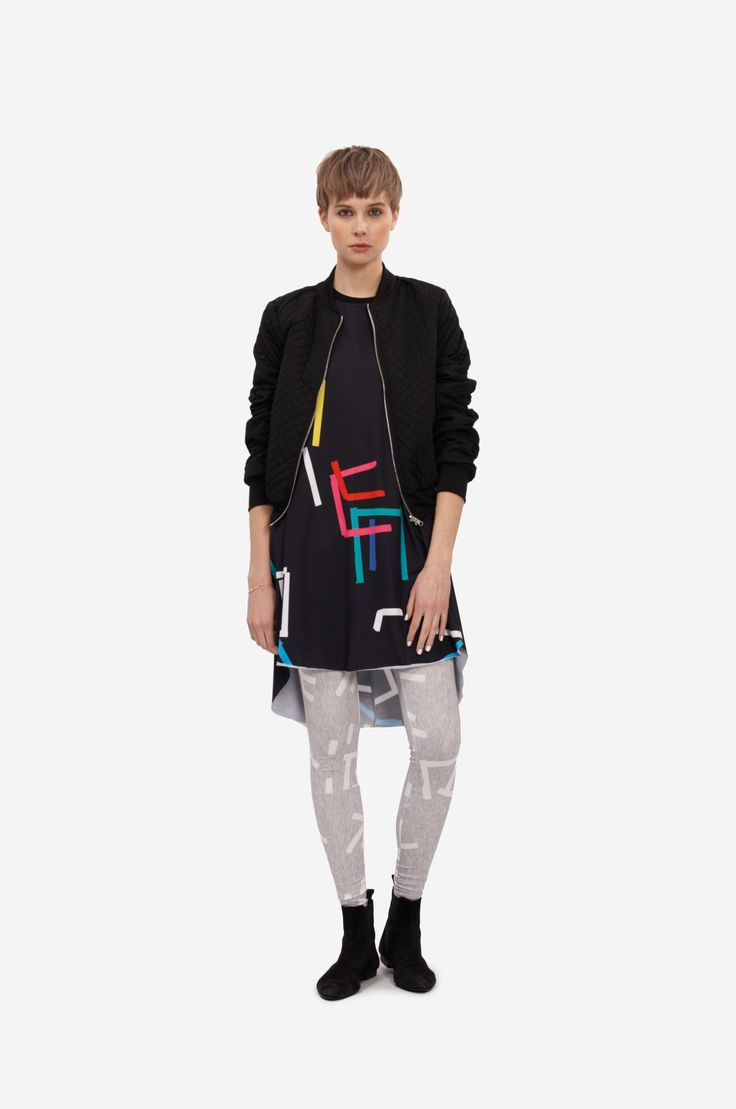 """DRESS """"COLOR PRINT"""" Shorthaired model wearing an a-line dress with short sleeves and original print. It is possible to roll up the sleeves. You can combine the dress with a bomber as shown in the picture. Model wears the dress together with original printed leggings."""