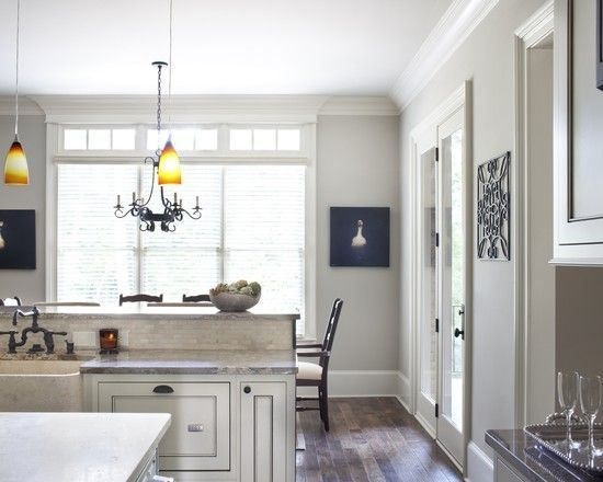 sherwin williams repose gray is the best gray paint colour with soft taupe undertones. Shown in kitchen with eating area