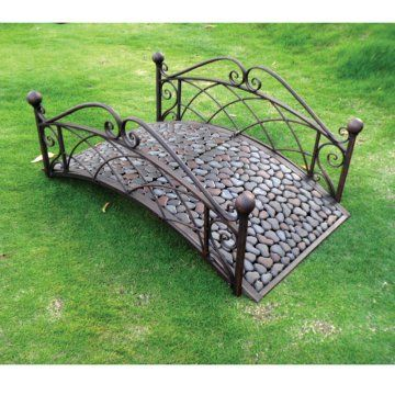 Garden Bridge neat , made from 2 old head boards and a wooden plank bridge with rubber mats