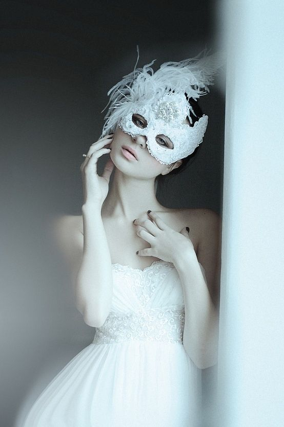 White masquerade mask and gown