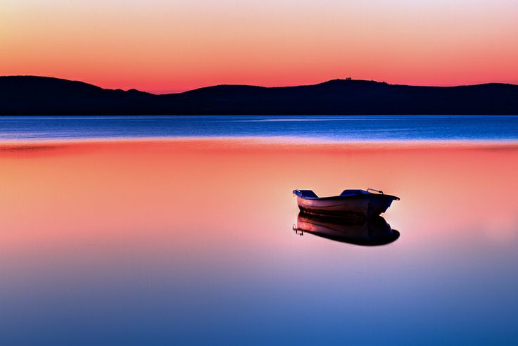Boat in sunset by Gert Lavsen