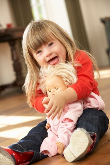 down syndrome girl with doll