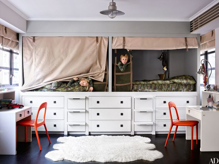 In accessories designer Fiona Kotur's Hong Kong home, the built-in beds, cabinetry, and desks in sons George (left) and Wyatt's room were made by local artisans; the ceiling light is by Pottery Barn Kids. We rounded up more than 40 stylish children's bedrooms and nurseries from our archives.