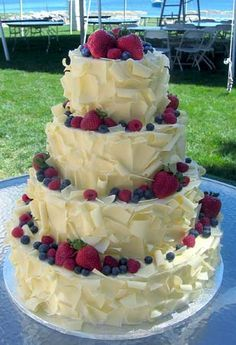 Looks yummy . . Cousin you must get your cake from the bread basket in Camarillo they have the best cakes I've ever had! (vanilla buttercream with their fruit basket option is amazing!) most of their cakes look like this but I'm sure they can make any wedding cake look you like! Go try it