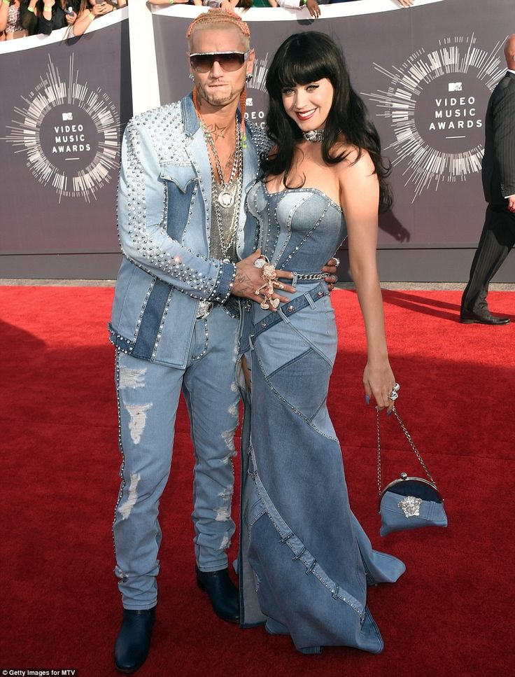 Double denim: Katy Perry was obviously the object of affection as she arrived with rapper Riff Raff in matching outfits at the 2014 VMAs http://dailym.ai/1oluLIj