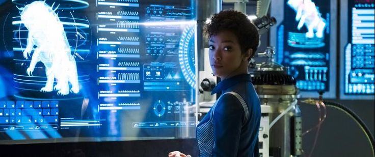 """FIRST LOOK: """"The Butcher's Knife Cares Not for the Lamb's Cry"""" Photos   The fourth episode of Star Trek: Discovery is titled """"The Butcher's Knife Cares Not for the Lamb's Cry"""" and new photos from it have just been released. Included are images of Michael Burnham interacting with two Discovery officers who are far from her friends at the moment Commander Ellen Landry and Lt. Saru. Also check out the displayed image of the creature behind Burnham in both the shot with Landry and the solo shot…"""
