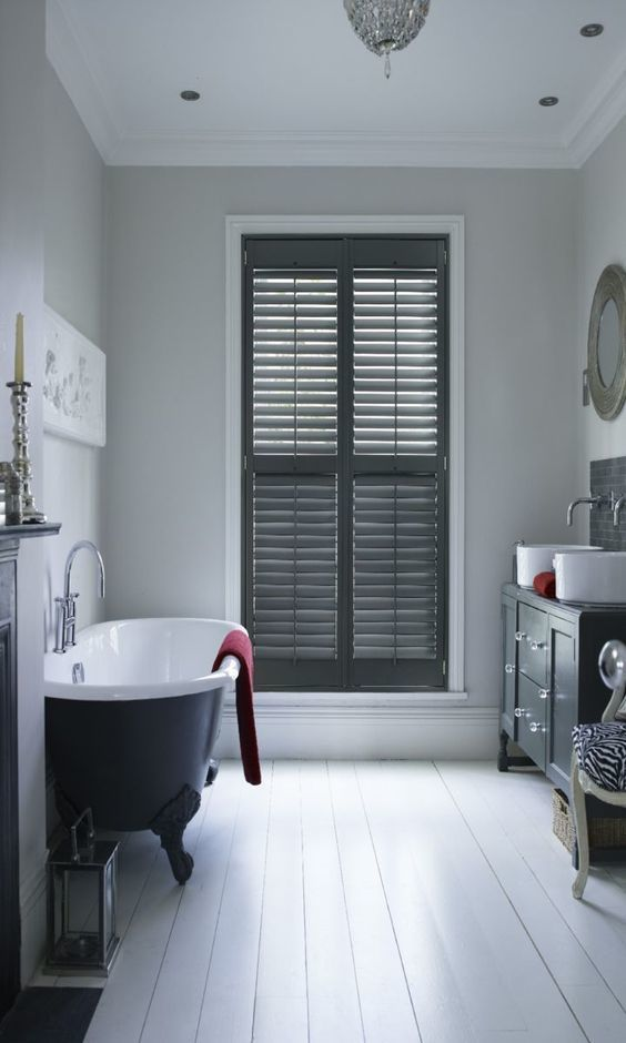 Use dark colour for features within a white room to add a subtle monochrome style to your home. Made to measure Darkwood Shutters would work wonderfully within this room.