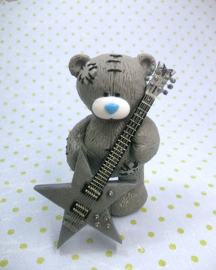 Kopolka: bear tutorial (use google translate) made with polymer clay but can also be done in fondant/gumpaste