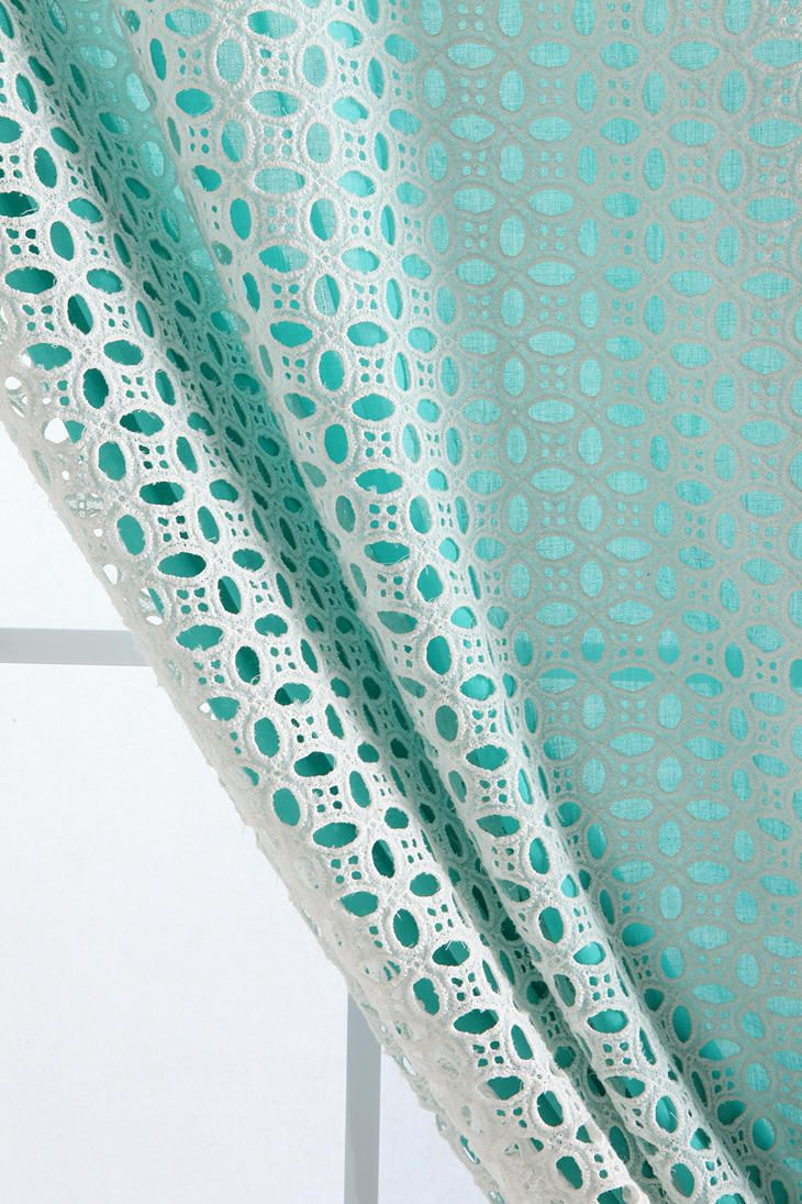Use lace over a solid-colored curtain to create texture
