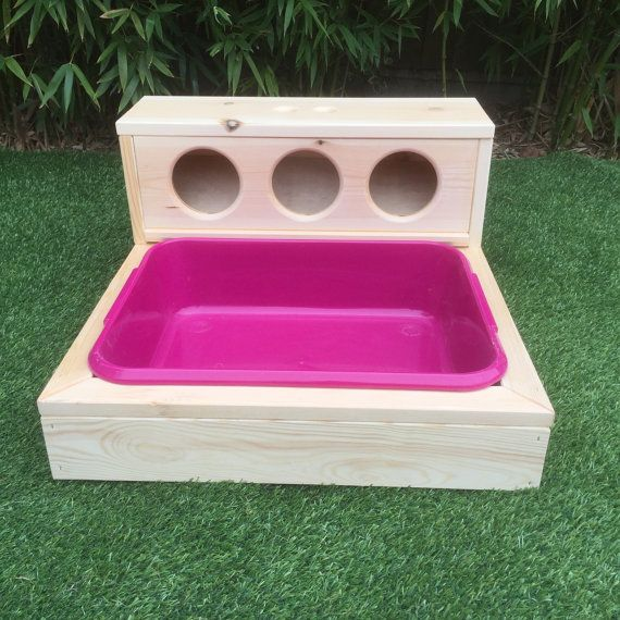 We call this the Deluxe Hay Bar  This is a hay feeding system with an integrated litter tray, which can be lined with hay or your preferred