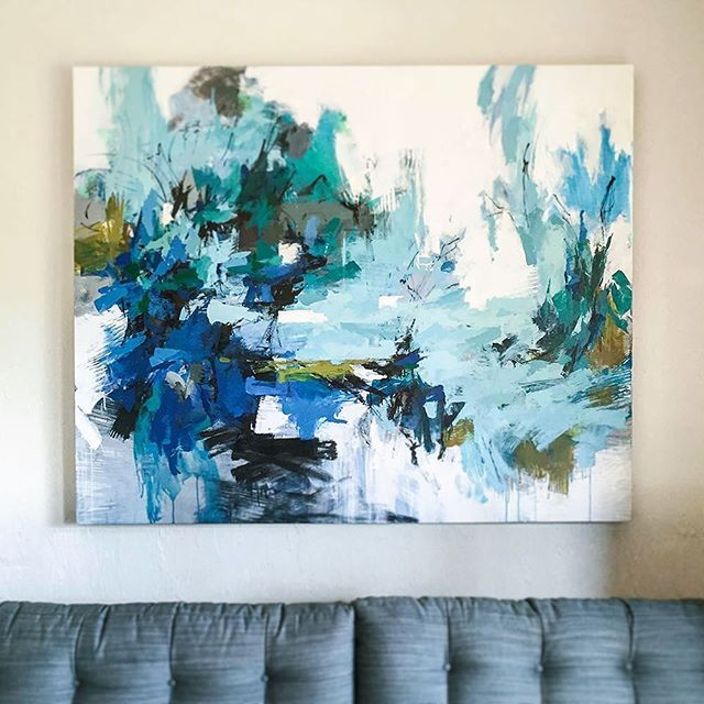 """Sitting on the Ocean Floor"" 45""x55"" abstract painting by Carlos Ramirez at Instagram. (Obviously hanging on a light colored wall.)Light background with lots of shades of blue."