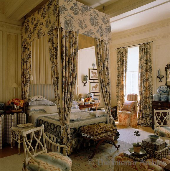 The master bedroom has a four-poster bed the height of the tall ceiling which is upholstered in the same fabric as the curtains - Stephen Falcke