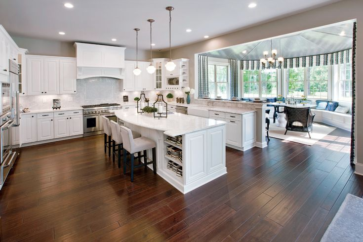 I love this kitchen.  I like the sunroom right off of the kitchen to let in lots of light.  Maybe close up the wall so it's flush with the end of the cabinets and move the range on that wall.  Then open up the wall where the range is to let in side light.