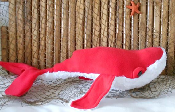 Big whale plushie measures 27 inches long and 7 inches in height. Taken from a wonderful pattern by Crafty Kooka , this whale is made from a red poppy colored fleece fabric to make it extra soft and cuddly. Its belly is a white minky cuddle stone fabric which mimics the barnacles found