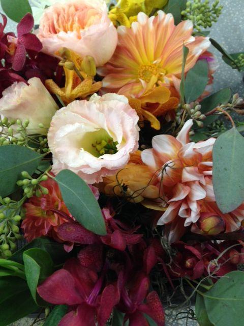 Dahlias, lisianthus, garden roses and mokara orchid centerpieces
