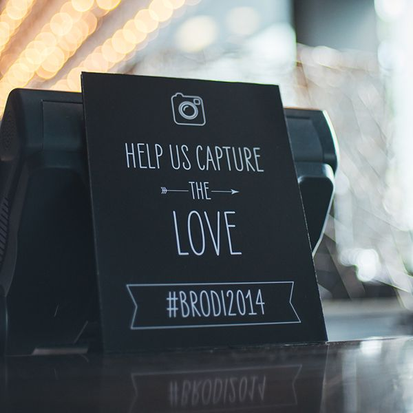 You spent months brainstorming a clever hashtag — make sure people use it! Create a clever sign to encourage your guests to snap and post the night away.