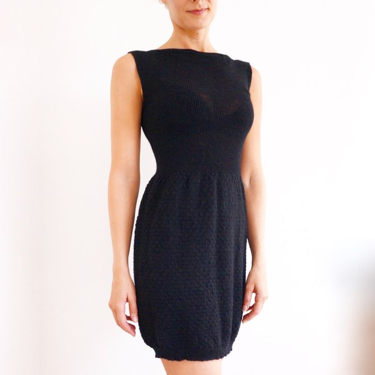 Rib knit and tuck knit sleeveless dress in wool.