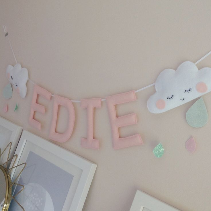 How lovely is Edie's name garland? Peachy pink letters and clouds with aqua and pink drops ❤️ #namegarland #namebanner #namebunting…
