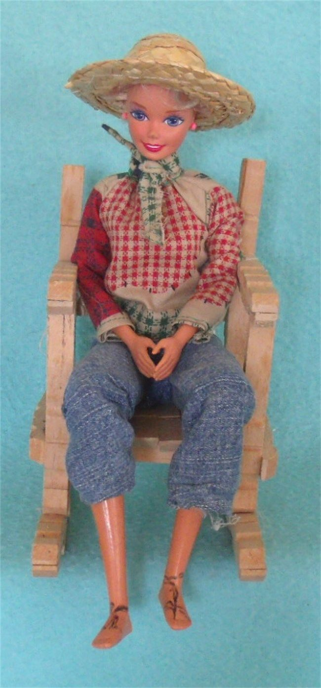 We have this country farmer Barbie in a rocker chair made from clothespins - in good condition - she is glued to chair for a cute display! Florida buyers must pay Florida sales tax before we can send the item out.