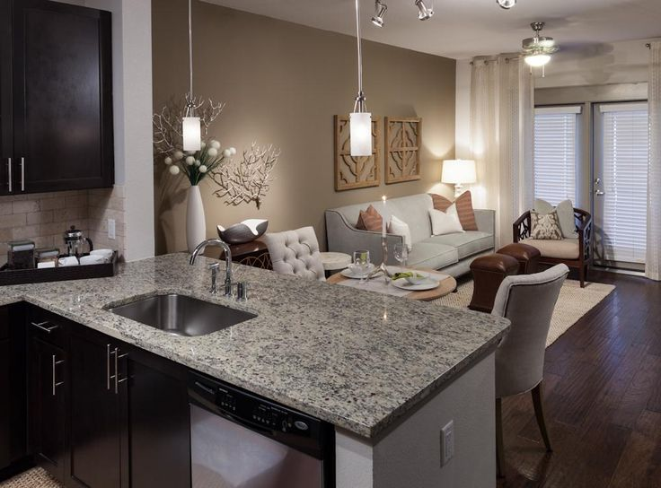 Model living and dining room at AMLI Ponce Park, a luxury apartment community coming soon to Atlanta!