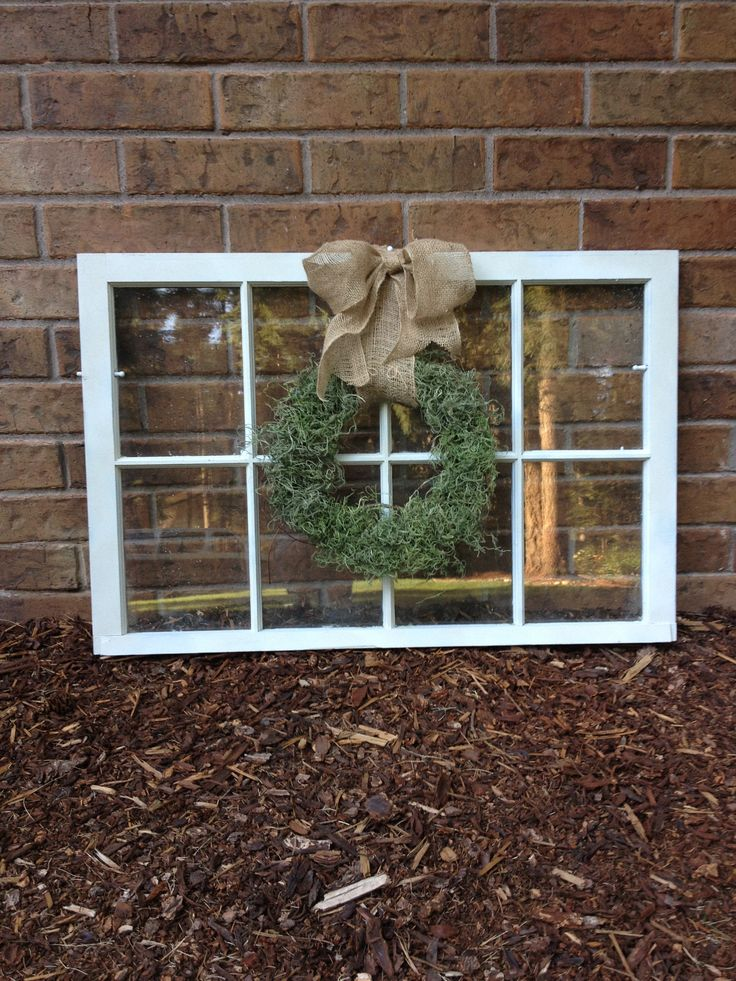 Repurposed window with DIY moss wreath. Great photo to follow when putting my window, wreath and bow together.