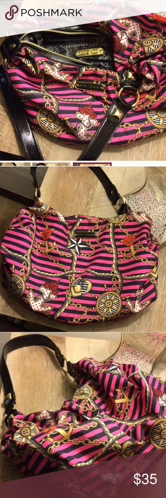 Betsy Johnson nautical purse Pink with black stripes, rope, anchors and other nautical themed designs. Great condition. Nylon purse, great shoulder bag. Love this purse, not sure I want to part with it, but thought I'd list it and see. Smoke free home. NO trades. Betsey Johnson Bags Shoulder Bags