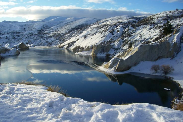 The Blue Lake at St Bathans Central Otago was created by man during the rush for Gold.