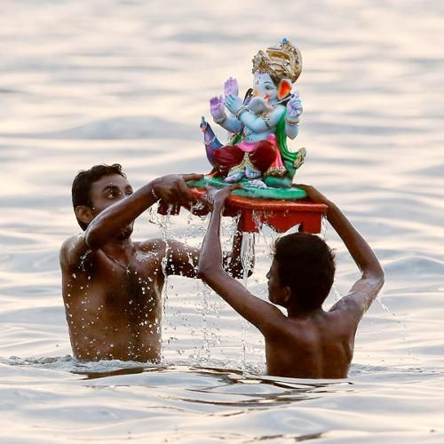 View Lord Ganesha's idol for puja Pics on TOI Photogallery