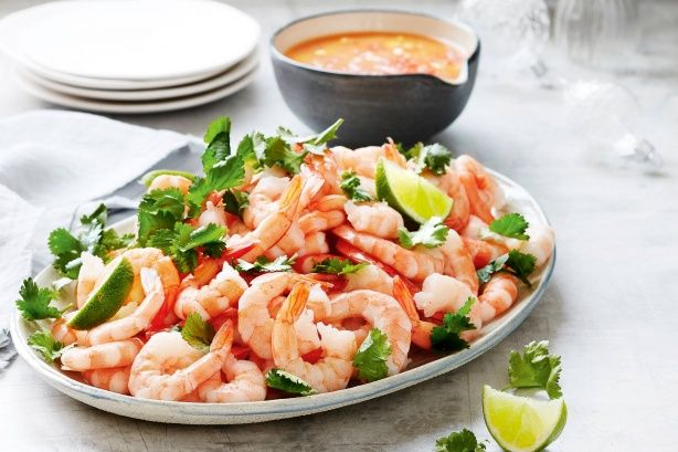 Pungent aromatics are blended with fresh juices and chillis to form a brightly flavoured, no-cook dipping sauce, also known as leche de tigre, to lightly coat the prawns. Finely diced mango and red onion speckled throughout adds a touch of sweetness.